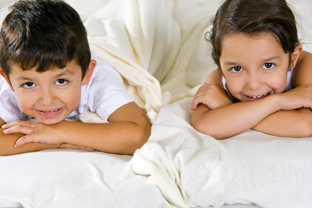 Cute brother and sister laying in bed Stock Photo - 5679730
