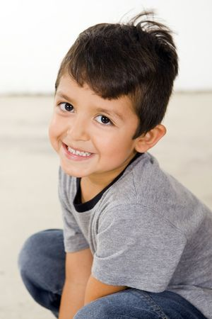 Cute and happy little boy photo
