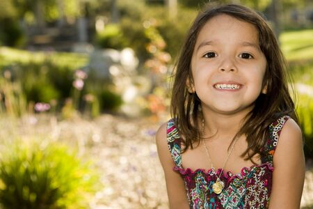 Cute little girl playing outside photo