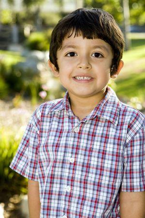 Cute little boy playing outside Stock Photo