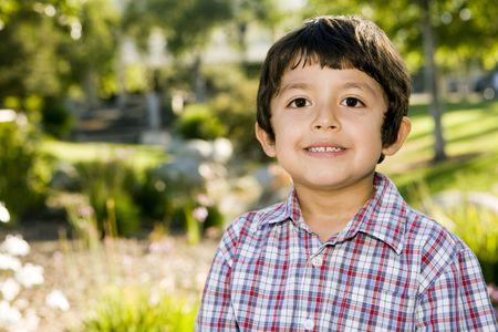 Cute little boy playing outside photo