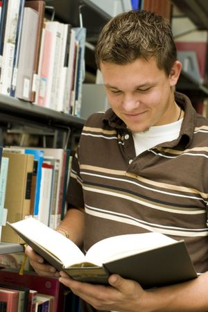Man looking at books in a library Stock Photo - 5679700