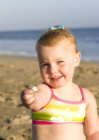 Beautiful little girl at the beach