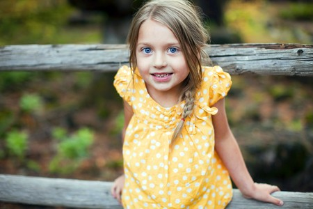 Portrait of a cute little girl outside photo