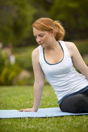 Young woman meditating yoga pose photo