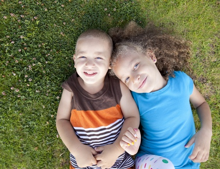 Brother and sister playing at a park