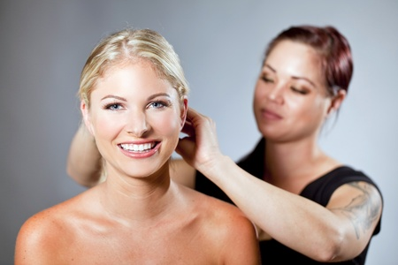 beauty saloon: Beautiful woman getting her hair done