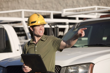 Attractive young construction worker with hardhat photo
