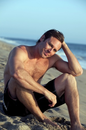 Young man at the beach photo