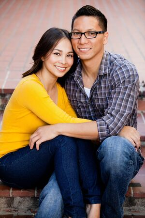 Ethnic young couple smiling and happy photo