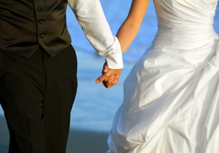 inlove: Close up of wedding couple holding hands Stock Photo