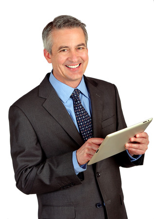 Portrait of a business man using a tablet Stock Photo