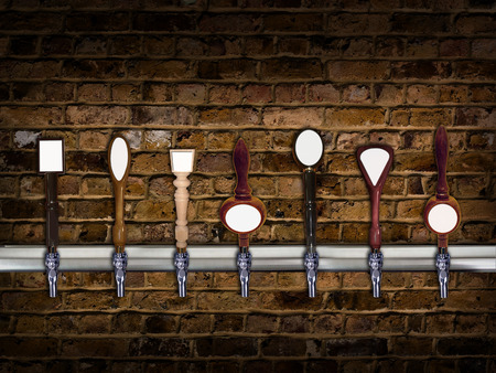 Multiple beer taps in a row with room for copy on each