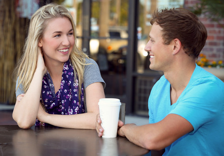courting: Young couple on a coffee date Stock Photo