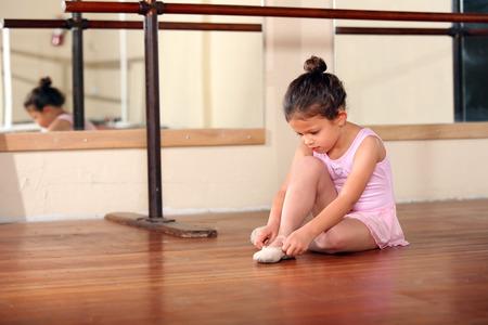 Cute little girl practicing her ballet