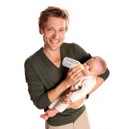 nursing bottle: Father feeding his newborn baby