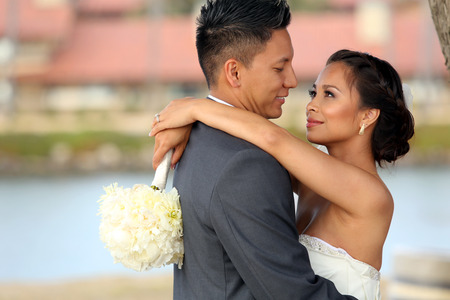 asian bride: Loving bride and groom at their wedding