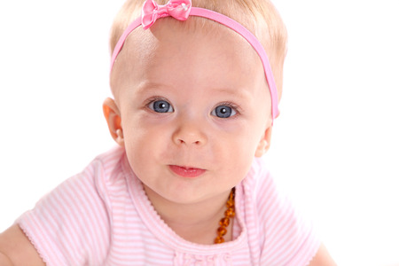 Adorable little infant girl on white background photo