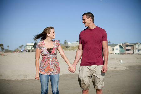 Attractive young loving couple at the beach photo