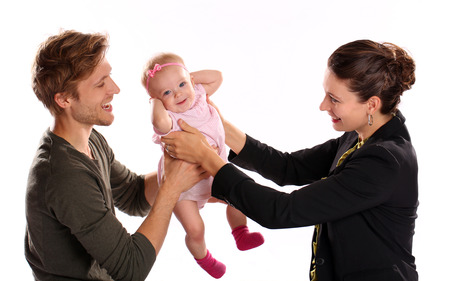 stay home work: Business woman and mother handing child to stay at home father  Stock Photo
