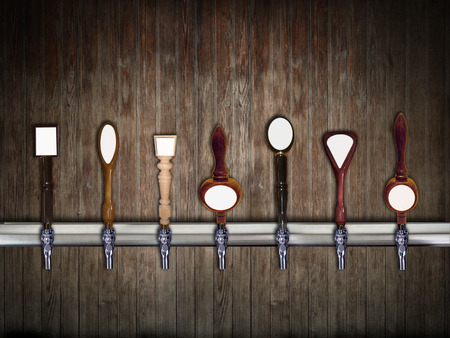 Multiple beer taps in a row photo