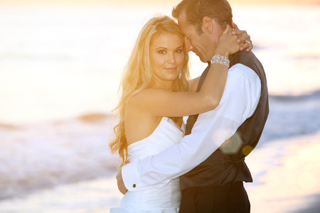 beach kiss: Happy bride and groom on their wedding Stock Photo