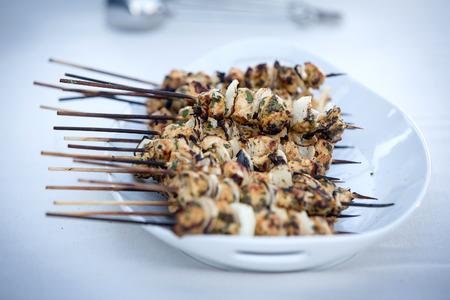 hoisin: Plate of grilled chicken kebobs