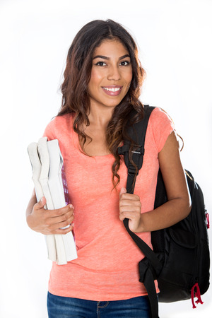 mexican girl: Happy young student with books and backpack