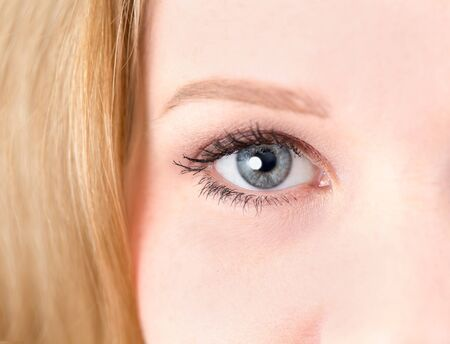 macr: Closeup of a young womans blue eye