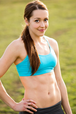 strong woman: Strong fit woman outside after her workout holding water bottle