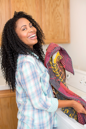 doing laundry: African american woman doing laundry