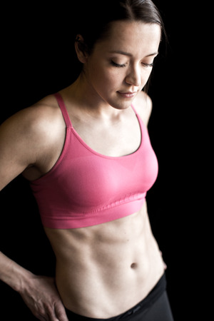 six packs: Fit woman with strong abs