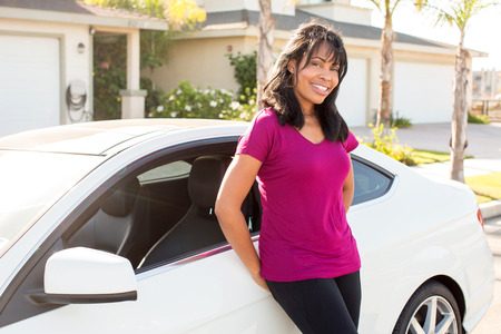 Attractive woman and her white car