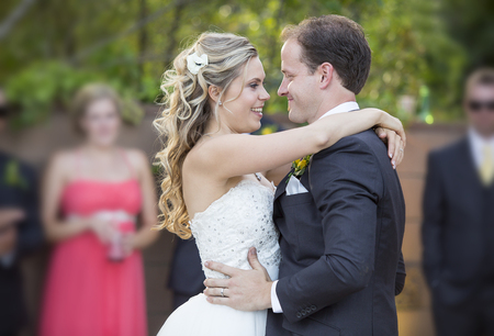 Loving newlyweds dancing on their wedding day Stock Photo