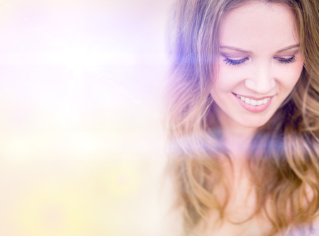Portrait of a beautiful happy woman smiling Stock Photo