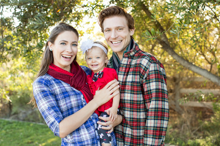 outsides: Happy young family standing outside