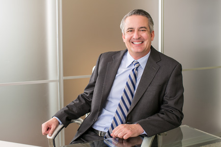 Mature happy smiling business man in an office