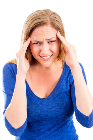 doctor burnout: Woman holding her head in pain with headache Stock Photo