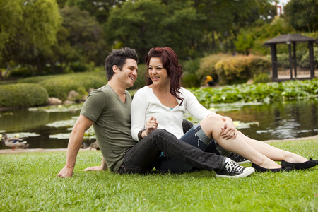 Young attractive couple in love at a park photo