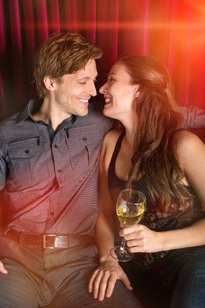 eachother: Couple flirting with eachother at a club Stock Photo
