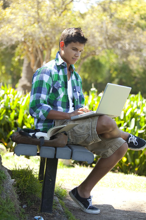 with pack: Student with backpack studying outside