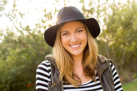 young women: Young trendy hipster woman in the park Stock Photo