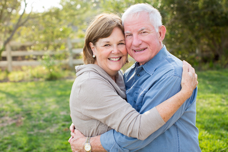 age old: Happy senior mature couple in love outside in nature Stock Photo