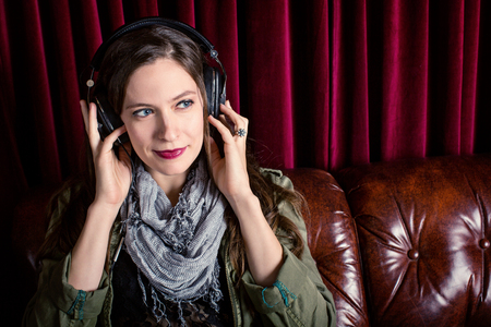 Woman listening to headphones in a club photo