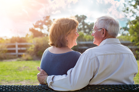 adult care: Happy senior mature couple in love outside in nature Stock Photo