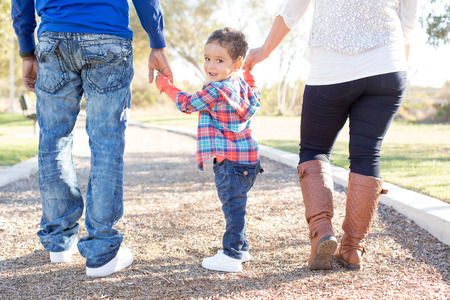 family outside: Multi cultural family together at the park