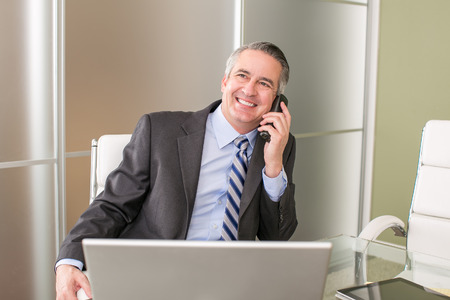 Mature happy business man on the phone Stock Photo