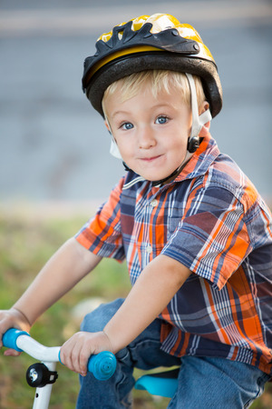 Young boy learning to ride bike