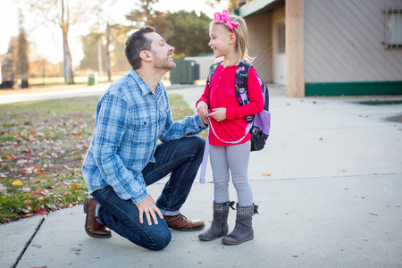 Father picking daughter up from school