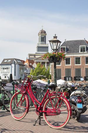 Red bike on a bridge in Amsterdam Netherlands Banque d'images